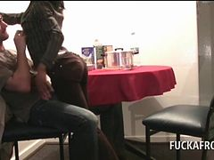 African slutty brunette blowing white penis on her knees