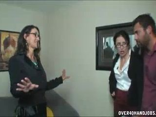 Two milfs jerking a naked guy